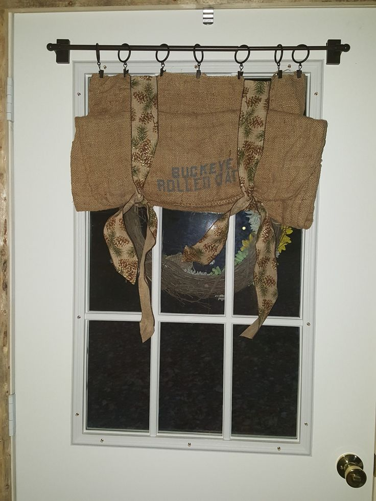 bought this burlap bag at a flea market it needed to be washed soaked in sink and washed twice air dried used pine cone ribbon and sewed ribbon to top