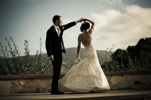 Love this Shot of the Groom spinning his Bride :)
