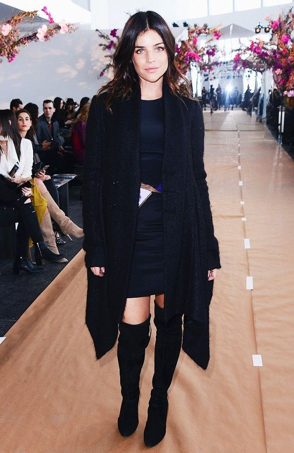 Julia Restoin Roitfeld wears a mini dress, coat, and over-the-knee boots