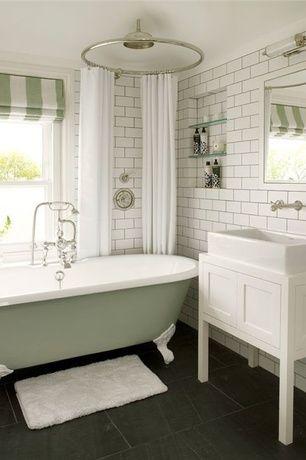 Traditional Full Bathroom with stone tile floors, Rain shower, Restoration hardware: round shower curtain rod, Bathtub, Flush