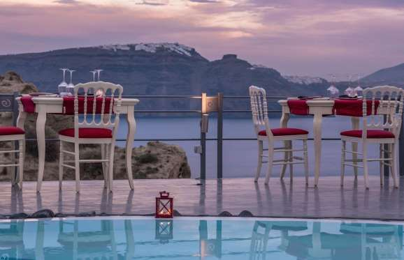 LAUDA RESTAURANT: SANTORINI, GREECE  There's no better place in Greece to chow down on traditional Greek organic products than at Lauda Restaurant, which is perched literally on the edge of a cliff. It's a restaurant of elegance where the chef provides th