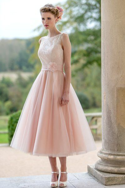 Tea length 50's style bridesmaid dresses are big for 2016. This one from True Bride is lovely