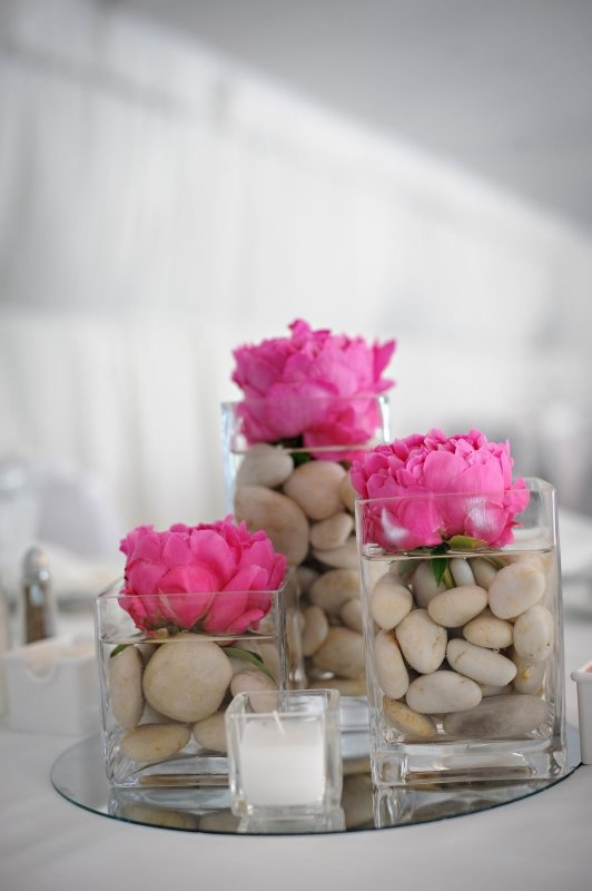 There is something so, so lovely about these designs. If you didn't like the stones, we could just float peonies on water, and stagger every other vase with a floating candle.