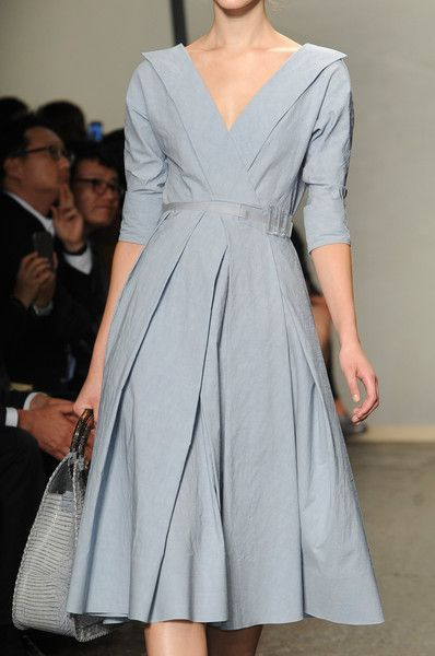 Soft blue pleated dress with portrait collar and full skirt. Donna Karan Spring 2013