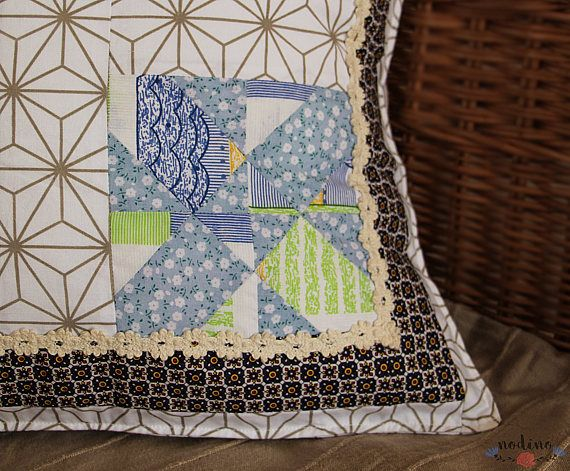A patchwork pillowcase for decorative pillows. Thanks to its lively colors and lace decoration with floral motifs it is a perfect choice for the living room, bedroom or for a babys room.  • MEASURE | 47x47cm / 18.5x18.5 inch • FABRIC | 100% Cotton • COLOURS | light blue, green, white, gold and dark purple • 100% handmade • Envelope closure (without buttons, also suitable for children) which makes it easy to insert the pillow • The interior is lined with white fabric • The cover is washab...