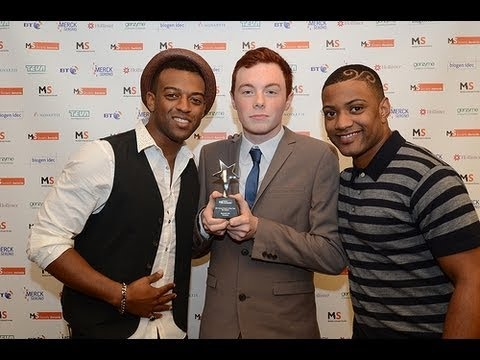 Ben Allister won MS Young Person of the Year at the MS Society Awards 2012. After his mum was diagnosed with MS, 17-year-old Ben organised a 90 mile cycle challenge to raise money to help people affected by MS. He raised more than £19,000 in just three months.    Oritsé Williams and JB Gill from JLS who presented him with his award.