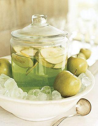 Caramel Apple Martinis ~ 2 parts of Butterscotch Schnapps, 2 parts Sour Apple Pucker, 1 part Vodka