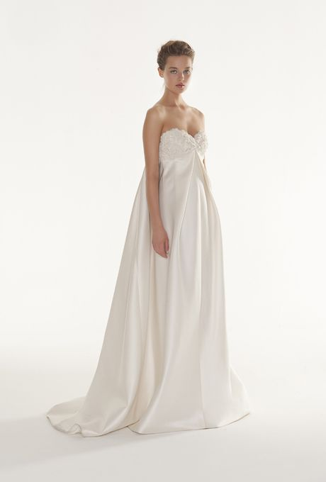 """Brides.com: Peter Langner - 2013. """"Bizet"""" empire silk magnolia and silk satin wedding dress with embroidered sweetheart bodice and flowing train, Peter Langner  See more Peter Langner wedding dresses in our gallery."""