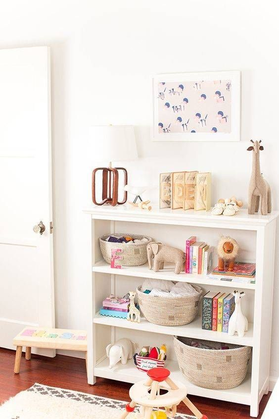 light and bright kid bedroom with white bookshelf for kid toy storage, wooden floors and white rug
