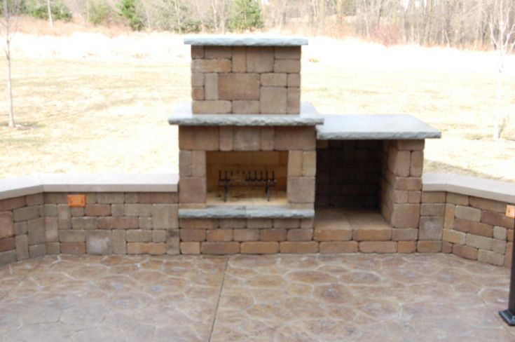 not too big fireplace in a retaining wall