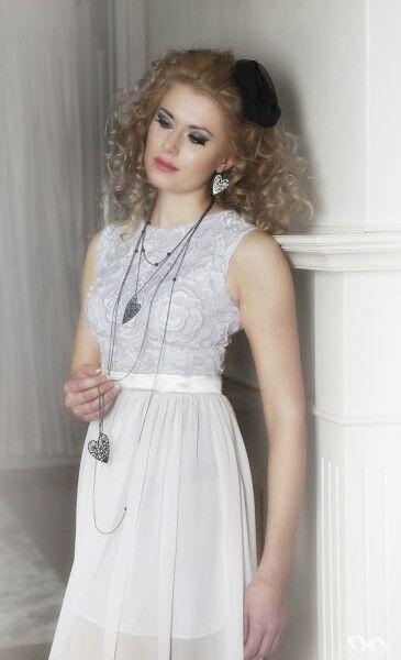 Sorella pendant and earrings. Photo: Nina Maaninka Dress: Sinikka Nikander Ateljee Pitsikukka Model: Katariina