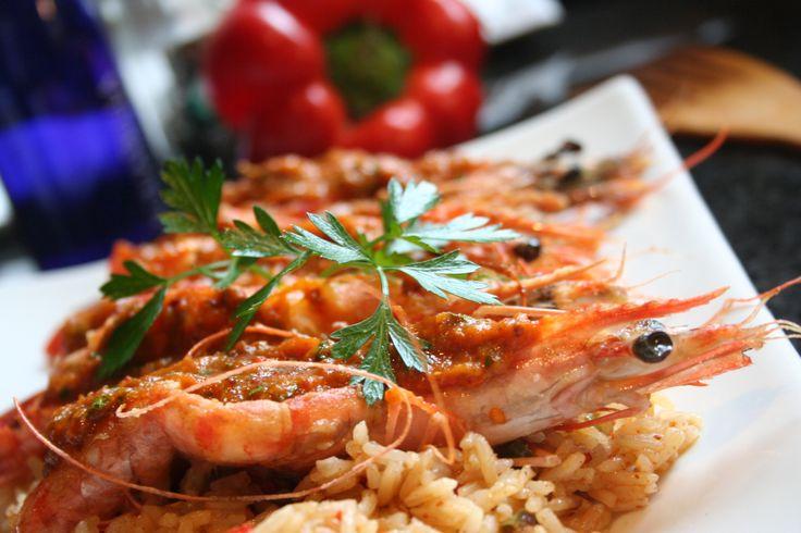 Chermoula topped prawns on pan fried rice