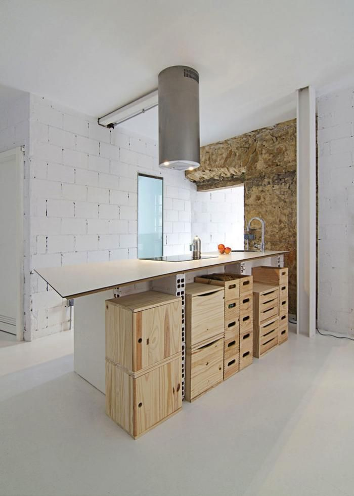 Plywood boxes with lids, open shoe-box style boxes, and drawers are neatly stacked beneath the countertop.