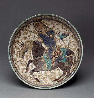 Bowl with prince on horseback, Seljuq period (1040–1196), 12th–13th century Iran Stonepaste; applied decoration, polychrone in-glaze and overglaze painted and gilded on opaque monochrome glaze (mina'i); H. 3 1/2 in. (8.9 cm), Diam. 8 9/16 in. (21.7 cm)