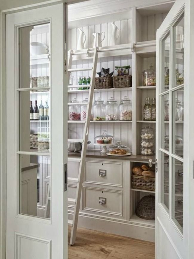 LOOVE THE IDEA OF HAVING A BAR FOR A LADDER TO REACH UPPER CABINETS. I ALSO LIKE DRAWER FRONT DESIGN