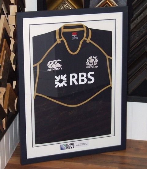 2011 Scotland Rugby Team shirt, framed in complimentary black and white.