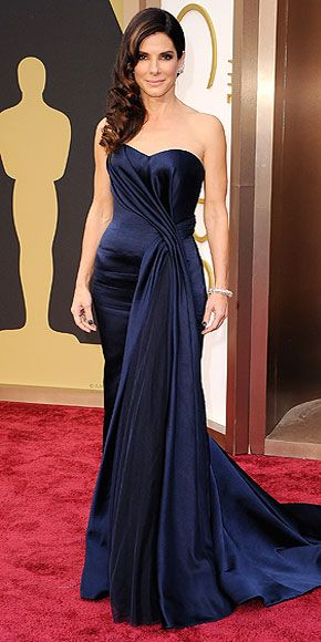 Sandra Bullock's Style Evolution | OLD HOLLYWOOD GLAM | From the side-swept waves to the draping on her Alexander McQueen gown to the diamond ear cuff, Sandra proves she's a true red carpet pro at the 2014 Oscars.