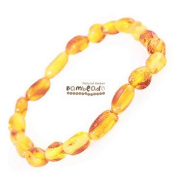 This may be alternative to help you with eczema,arthritis or general aches and pains.This 18cm Bambeado amber adult Honey bean bracelet is made from large bean shaped amber pieces that have been polished so that there are no sharp edges. The amber beads bracelets are mounted on a strong elastic thread and are gorgeous on. While Bambeado amber comes in several colours, the colour is just a matter of personal choice.