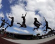 Multiple exposure frame, showing Brittney Reese competing in the Women's Long Jump Final at the U.S. Olympic Track and Field Trails on Sunday, July 1, 2012, in Eugene, Ore.  (AP Photo/Charlie Riedel)