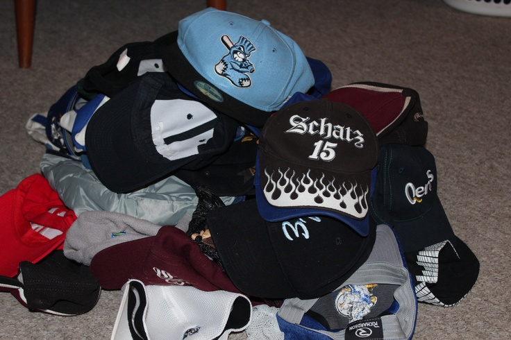 June 6 - Today's photo is Hat. I could not just pick one..... This is just a few of the hats we actually have - we keep them in a wheelie bin. Showing 2 of my faves - the Sydney Blue Sox and the glow in the dark Donny Schawtz.....