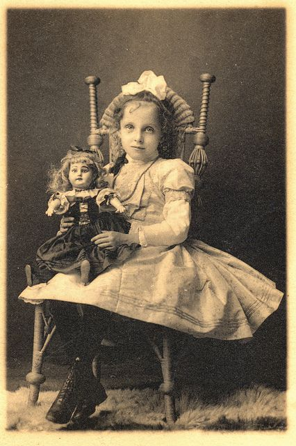 Her intense gaze and the beautiful doll both help make this Victorian portrait an especially memorable one. 1800s