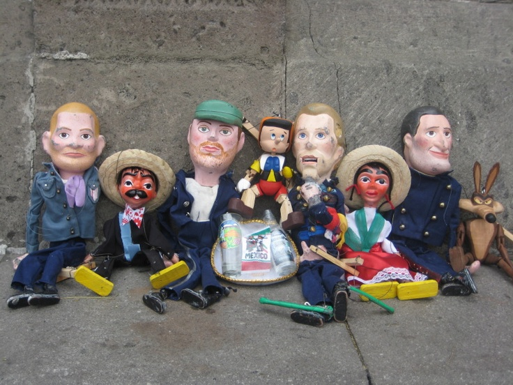 I was in Mexico after 2 hours sleep and armed with a hangover trying to find a bracelet I'd wanted for years. En route we were also trying to find an interesting place for the Coldplay puppets to have their photo taken. Given the state I was in, I thought I was hallucinating when I saw this little lot!
