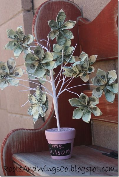 Good tips for making a Money Tree; I especially like the origami flower tutorial. Not loving the flower pot base pictured though.  -tkz