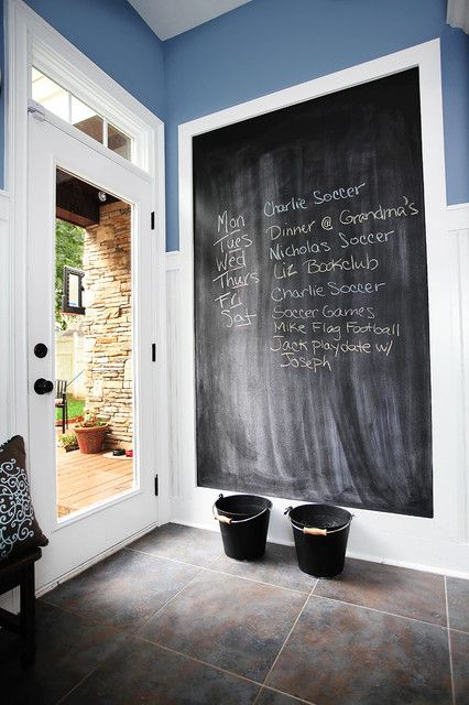 framed chalkboard Entry Farmhouse with blue walls chalkboard chalkboard paint functional mudroom paneled walls