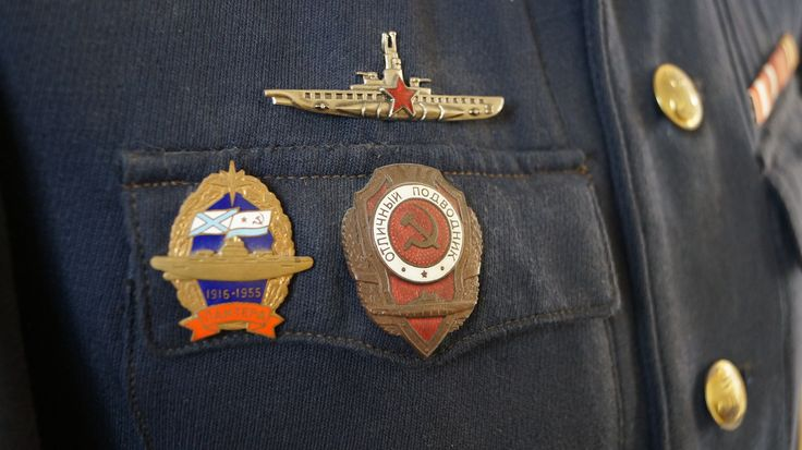 """Soviet Navy """"excellent submariner"""" badge, Submarine Commander Badge and commemorative Soviet Union Panther badge."""