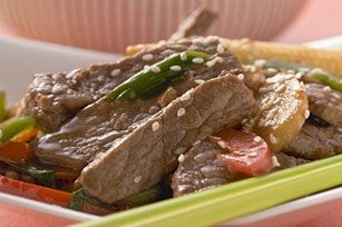 Thin slices of boneless beef sirloin steak cook up quickly in this tasty Asian-inspired stir-fry made with fresh green and red peppers.