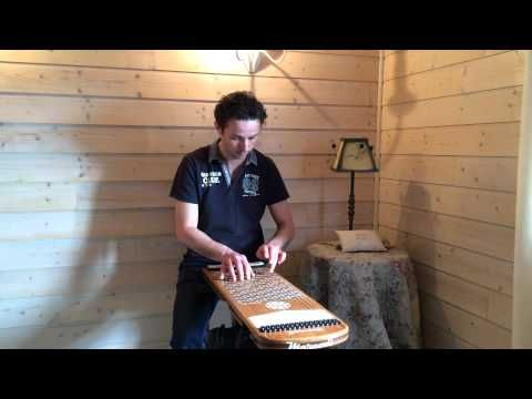 how to play the harpejji