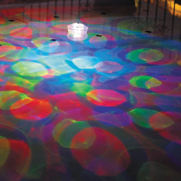 And these colorful underwater light projectors: | 12 Totally Radical Grown-Up Pool Accessories