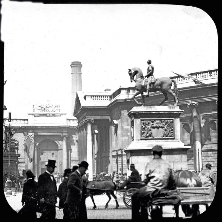 Once the oldest in Dublin, the statue of William III, by Grinling Gibbons, was unveiled on 1st July, 1701. By the time this photograph was taken, however, the statue had been repaired several times, the head, as well as several limbs, having been replaced at least once. The statue was finally destroyed by an explosion in 1929