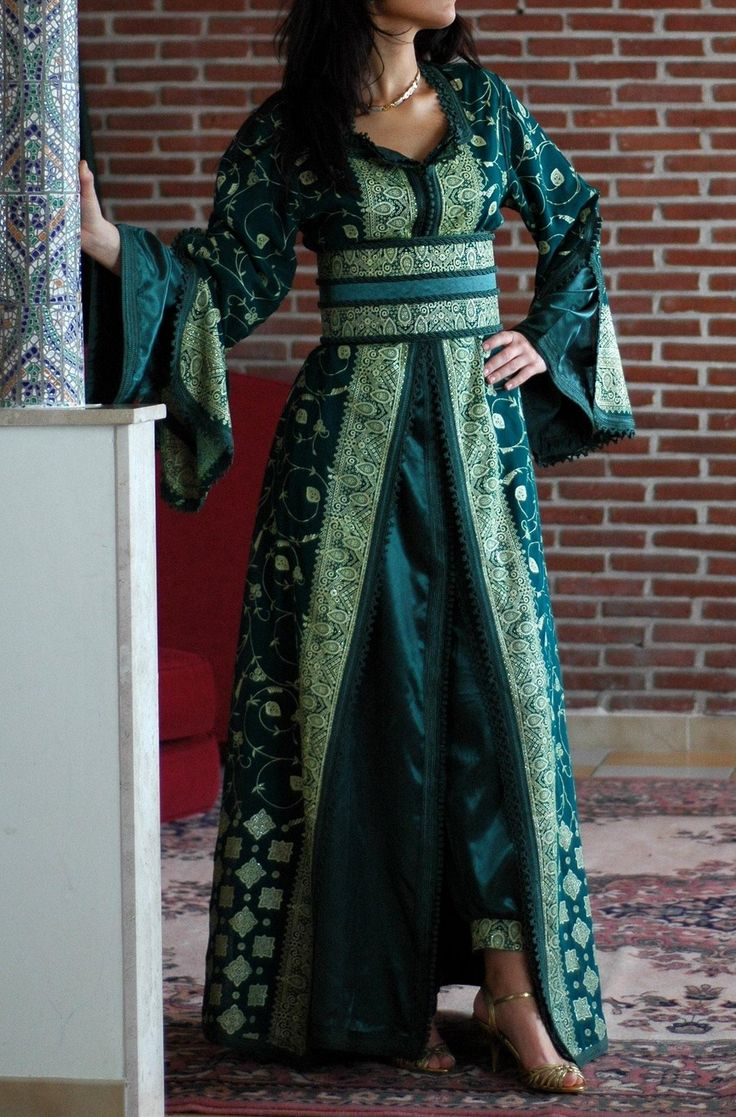 """Morrocan Clothing    *jellaba: a long hooded garment worn over other clothes by both sexes, an everyday article of clothing.    jabador: any combination of pant and shirt set, usually in matching fabric for men and women.    caftan: a single """"dress"""", traditionally with long sleeves, a belt, and worn over loose pants; women only and for special occasions    takchita: similar to the caftan, but composed of two pieces. Considered by some to be the more elegant of the two formal """"gowns'."""