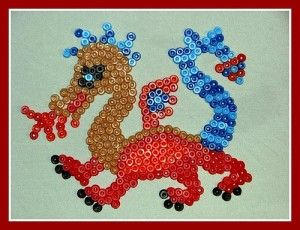 The Little Dragon - Created with buttons - or perhaps sequins.
