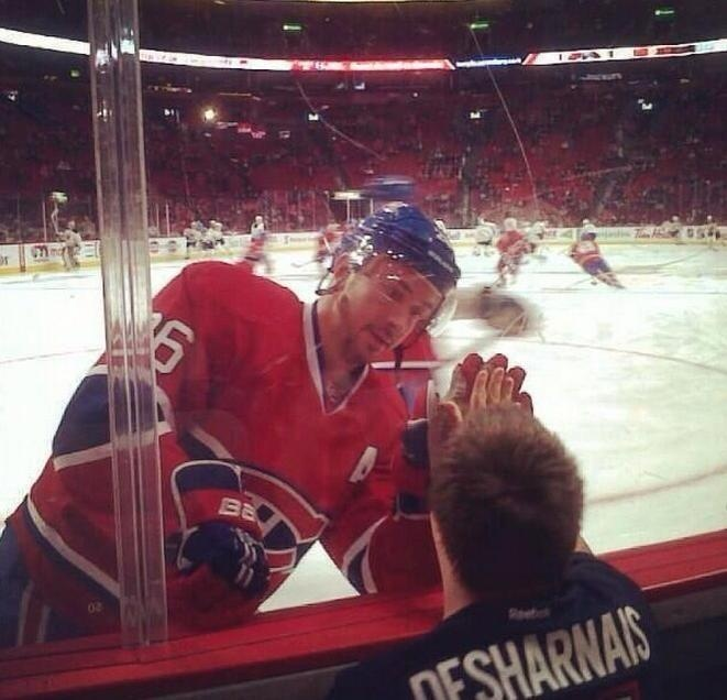 Awesome picture of Josh Gorges saluting a fan during warm up at the Bell Centre.