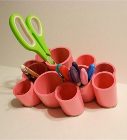 Create a desk organizer out of PVC pipe.