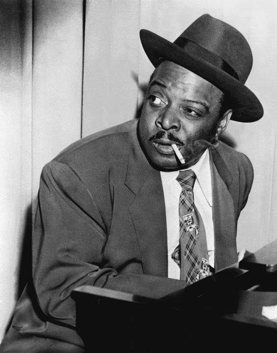 """William James """"Count"""" Basie, Aug. 21, 1904 – Apr. 26, 1984 was a Jazz pianist, organist, bandleader, and composer. His mother taught him to play the piano and he started performing in his teens.  By 16, he increasingly played jazz piano at parties, resorts and other venues. In 1924, he went to Harlem,expanding his career he toured with groups to jazz cities like Chicago, St. Louis and Kansas City. In 1929 he joined Bennie Moten's band in KC, he played with them until Moten's death."""