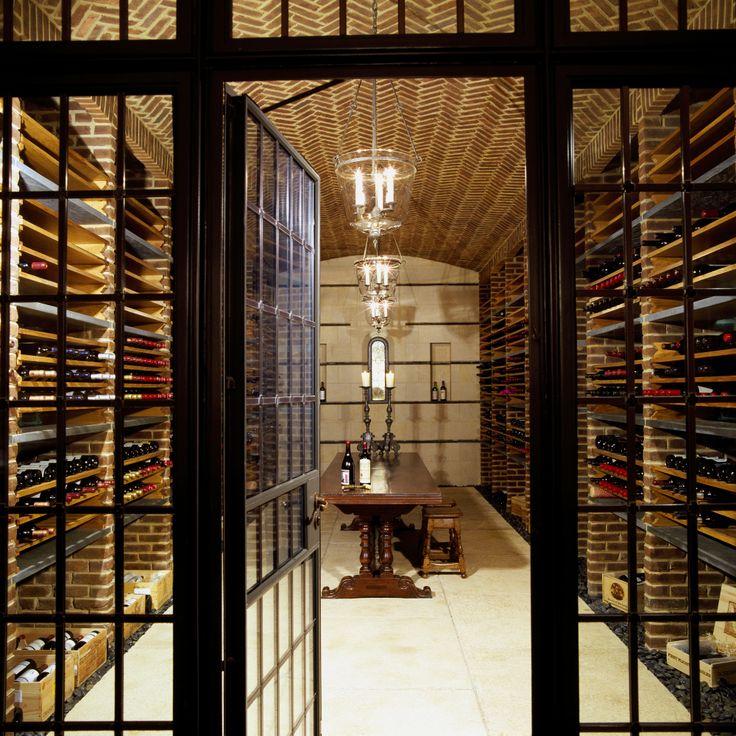Bricks hold up slate shelves in the wine cellar.