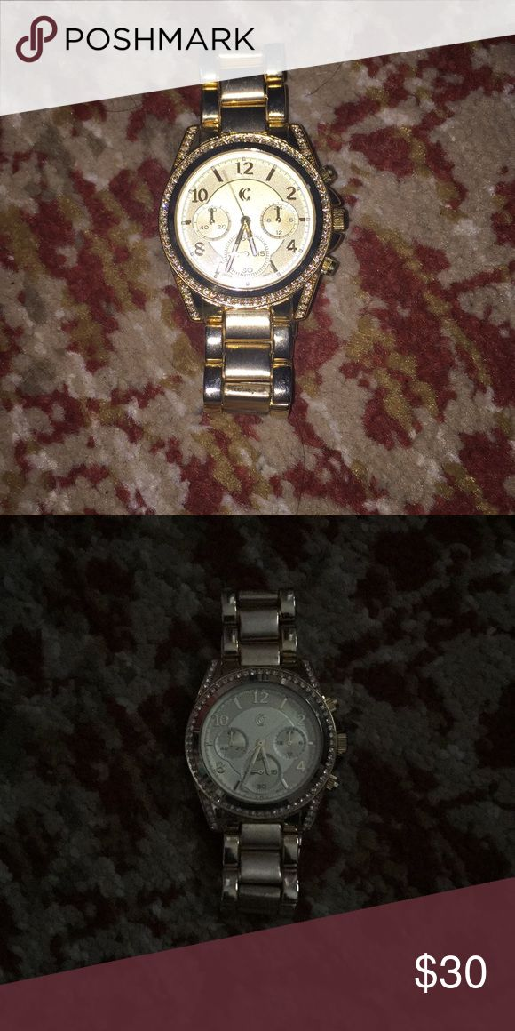 Gold watch Gold and crystals watch never been worn, works perfectly  ( not real gold) Charming Charlie Jewelry Bracelets