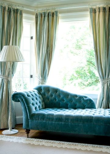 Big window + long curtains + chaise lounge. Not in these colors though.