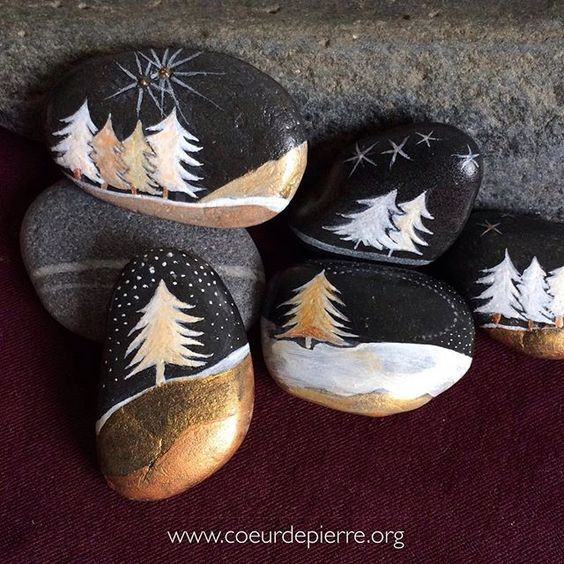 Trees painting on black rocks with pretty gold metallic paint and white. Fancy looking painted rocks!