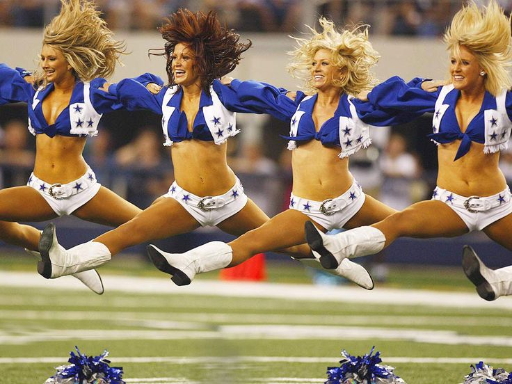Dallas Cowboys Cheerleaders Bend Over   These gals love boots so much that they jump, split and cheer in them!
