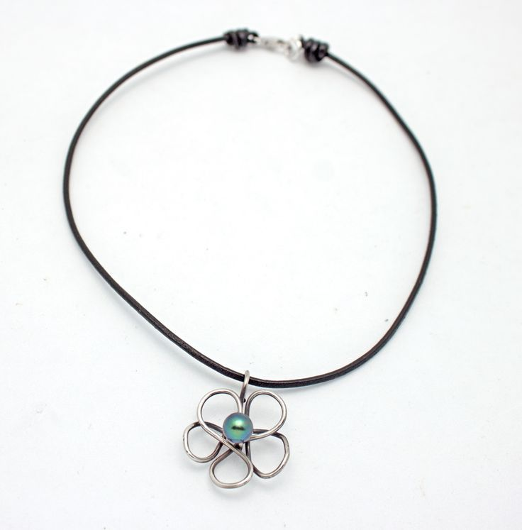 This necklace is a simple design using black leather, a freshwater peacock colored pearl, and oxidized sterling silver wire shaped into a flower. When it comes to custom jewelry, the possibilities are endless. #Gempacked