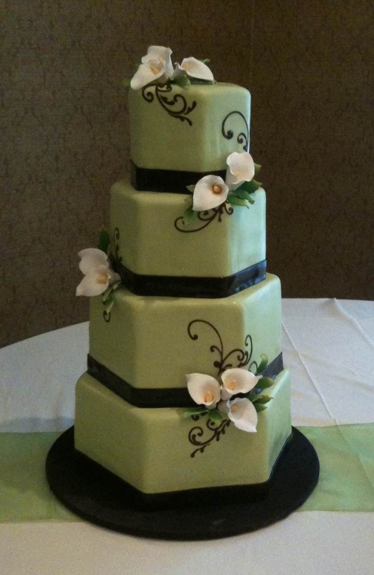 A contemporary calla lilly wedding cake - would change the green for a white cake, and black ribbons for gold. Some pearls as well! Love the hexagon shape!