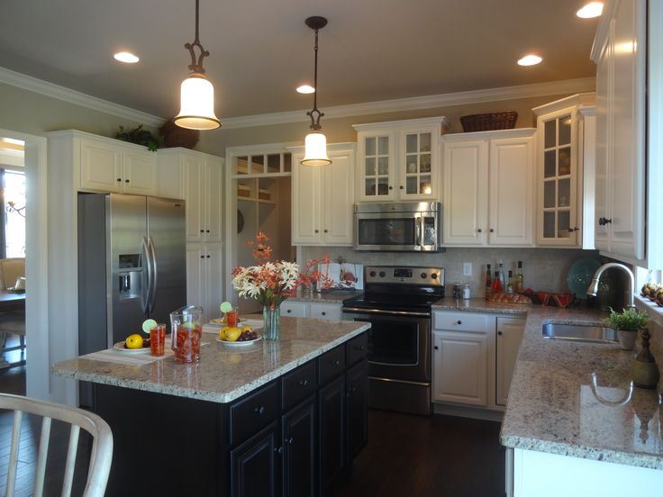 ... Kitchens Can Be Seen In Our Amber Fields Parade Home.antique White  Cabinets With An Espresso Island! All Our Cabinets Are From Swartz Kitchens  U0026 Baths.