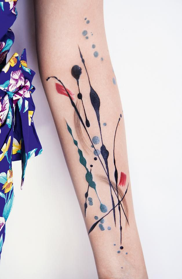 Abstract and colorful arm tattoo by NYC based artist Amanda Wachob