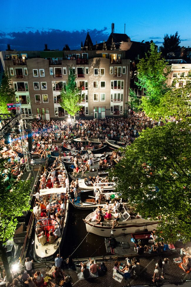 Grachtenfestival is a week-long outdoor classical music festival held every August in Amsterdam.   The festival's grand finale, the free Prinsengracht Concert, is held on a floating barge on the Prinsengracht Canal in front of the Pulitzer Hotel. Starting that morning, thousands of boats, large and small, stake out their spots. Day-long floating parties culminate in a shimmering, magical concert held under the stars. >>> Sounds awesome