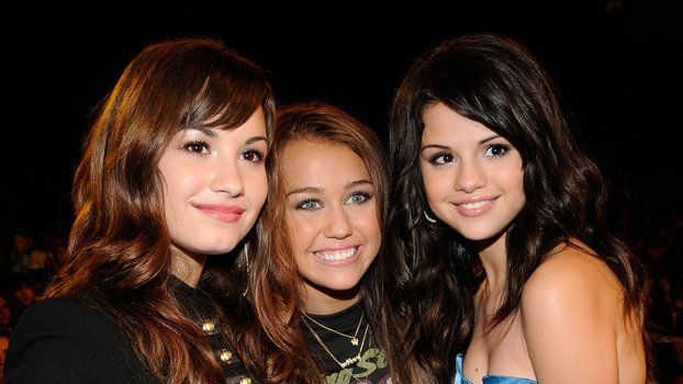 Selena Gomez Miley Cyrus and Demi Lovato Just Had a Musical Reunion of Sorts