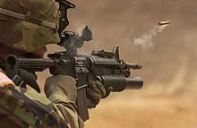 The M-4 Carbine is a gas-operated, magazine-fed, selective fire, shoulder-fired weapon with a telescoping stock. A shortened variant of the M16A2 rifle, the M4 has a 14.5 in (370 mm) barrel, allowing its user to better operate in close quarters combat. Like the rest of the M16 family, it fires the .223 caliber, or 5.56mm NATO round; Wikipedia